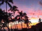 Enjoy Hawaiian sunsets with a cocktail
