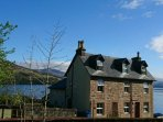 large lochside holiday house near Skye and Plockton. sleeps 18 in 8 bedrooms.dogs welcome