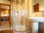 There is a newly installed family bathroom with a large deep bath and separate shower enclosure