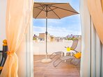 This sunbathing terrace is ideally located as you step out of main bedroom