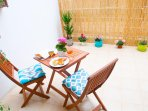 Enjoy the shade of the terrace late afternoon after your dip at the beach