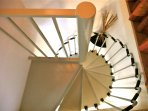 Modern spiral staircase with handrail