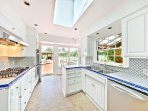 Beautiful kitchen just steps from poolside.