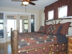 Main level bedroom w/king size bed, private enclosed patio overlooking the lake