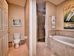 Private lavatory and walk in shower in the master bathroom.