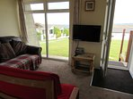 Lounge with sea view 32in Television with built in dvd