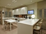 Large modern kitchen leading to the back garden