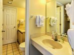 Freshen up for the day in this nice bathroom.
