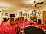 The red velvet carpet makes this game room pop.