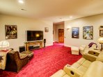 Sink into the leather recliner chairs and enjoy movie night from this home theater movie system.