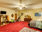This second bedroom offers workout equipment and a flat-screen TV for your convenience and entertainment.