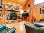 This dynamite cabin is loaded with charm and rustically decorated in mountain themes.