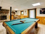 You'll find a pool table for your group to enjoy along with additional seating and a decorative fireplace.