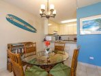 #8-310 Dining area with surf board wall art