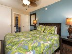 #8-310 Bedroom with queen size bed
