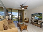 #8-310 Living room with flat screen television and lanai