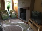 Living room with sofa bed, open fire, large flat screen TV, dvd, Netflix & internet