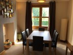 Large dining room with seating for 6 people.
