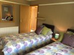 second bedroom - can be set up as one king bed or two single. TV, dvd, hairdryer, wardrobe