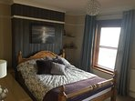 Master bedroom with very comfortable King size bed, ample wardrobe and storage, tv, dvd, hairdryer