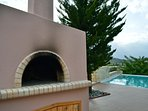 Prepare meals at the wooden oven