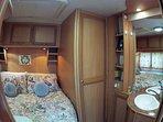 Vanity and bedroom.