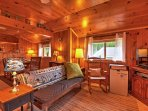 Relax in the rustic living area as you watch your favorite program on the cable TV.