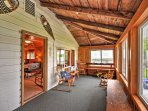 The screened in porch offers a stunning view of the water.
