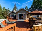Deck includes HOT TUB, ample room to sit and lounge and outdoor bar.  New Grill!