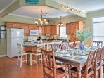 Enjoy a meal at the breakfast counter or sit down with the whole group at this large dining table set for 10.