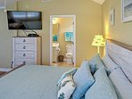 The master bedroom boasts a king-sized bed and en suite bathroom.