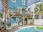 With a private pool and grilling area in the backyard, this beach house is sure to feel like Southern paradise!
