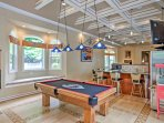 The game room is furnished with a poker table, a pool table, and a high-definition cable TV.