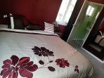 Master bedroom with comfy California king Beautyrest World Class bed and 50' TV
