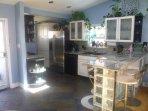 Modern kitchen with coffee maker, dishwasher, ice maker, wine fridge, etc.