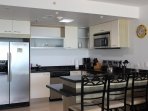 Luxury kitchen with refrigerator, stove, dishwasher, microwave, coffee maker etc
