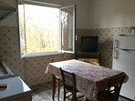 Typical rural 1960s' kitchen/dining area with window towards rear garden.