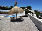 Relax by the pool under the new parasols