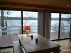 dining room table by the fire place and with a lake view