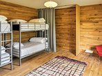 4 guests can be accommodated by these twin-over-twin bunk beds.