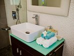 Feel comfy to use one of the bathrooms where you are provided free and fresh towels, new linens