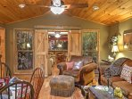 The unique interior of this home is outfitted with  rustic wood paneling and oriental style decor.