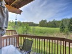 A lovely pond and lush green trees paint the picturesque landscape that surrounds the backside of the property.