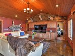 Watch your favorite shows on the flat-screen cable TV in the open living room.