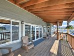 Everyone in your group can relax in the wooden Adirondack chairs on the deck.