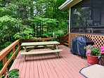 Lower deck area has a gas grill, picnic table, lounge chair and two person swing. Beautiful View!