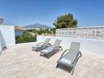 Rooftop terrace  Solarium w/ bar, sink, fridge and shower.  Amazing views to La Concha mountain.