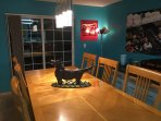 Bad dog! Off the table! Ranch Dog shows off our oversized dining room table set.