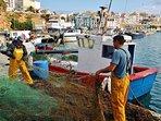 Pescadores faenando