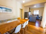 Huge kitchen with spacious dining area leading to outdoor alfresco dining area